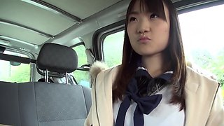Asian shows tits off in the backseat and sucks driver's cock
