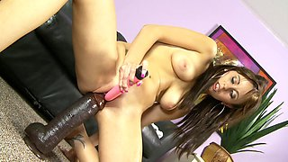 A brunette that loves to play with toys is riding a dildo