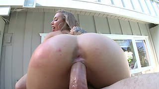 One of the sexiest porn actresses performs action at the pool