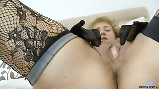 Deliciously curvy mature teases as she strips out of her