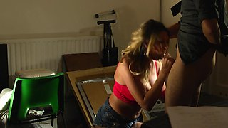 Big-titted slut gives detective a blowjob in order to be released