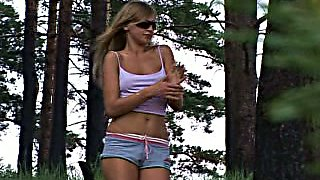 Real tanned chick flashes her small tits and pisses near the tree