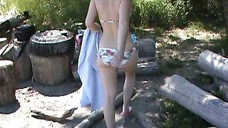 Skinny bikini teen fingers pussy in public beach