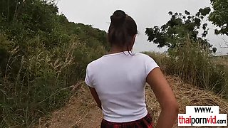 Amateur Thai teen Cherry fucked by a big white cock from behind outdoor