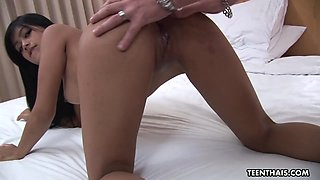 Authentic Thai girl with dark pussy and nipples is tucked by one European guy