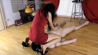 Slender Asian dominatrix in high heels punishes her slave