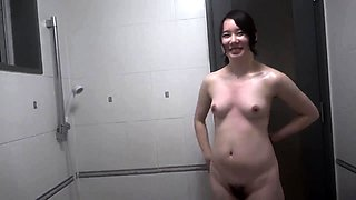 Adorable Asian babe exposes her sweet body in the shower