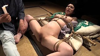 Lovely Japanese housewife getting tied up and fucked rough