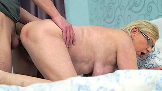 Hairy granny's pussy gets penetrated by youngster's cock