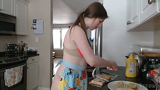 Sassy babe Gemma Minx prepares breakfast and exposes her naked boobs