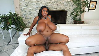 A black woman that has huge curves is getting fucked really hard