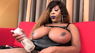 Chubby Nubian shemale solo jerking on couch