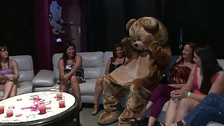 Muscular male stripper is called over to a bachelorette party