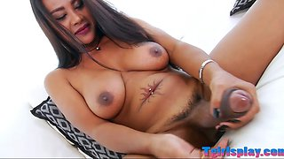 Sultry tgirl Jasmine masturbates her cock on the couch