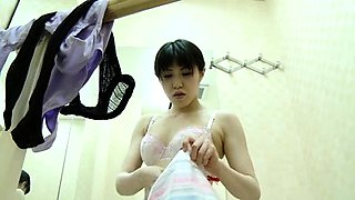 Voyeur spies on a beautiful Japanese girl changing clothes