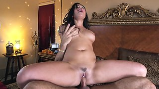 Pretty bitch with large tits is penetrated doggy style on the bed