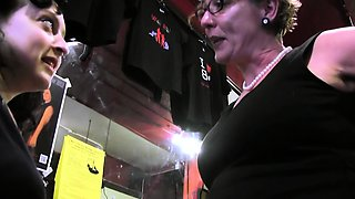 MILF in glasses spanks her stepdaughter's ass in the shop