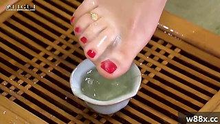 The beautiful feet of Cheongsam sisters