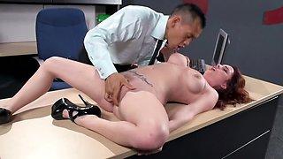 Dominant businessman slams redhead new secretary on a table