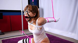 Beautiful Japanese babe in lingerie gets schooled in bondage