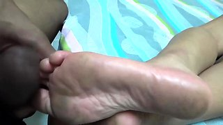 Horny husband sprays his wife's sexy feet with jizz in POV