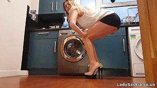 British MILF in the kitchen in miniskirt and high heels