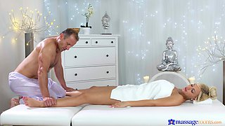 Oiled blonde cutie massaged and fucked by a large white dick