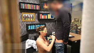 Secretary caught on camera giving a blowjob to her boss