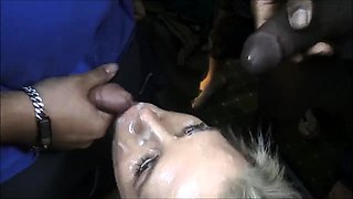 Attractive blonde has a group of guys unloading on her face