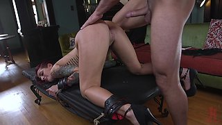 Long haired redhead Tana Lea strapped to a desk and doggy fucked