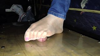 Dominant amateur babe punishing a meat prick with her feet