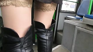 Gal flashing nylons in a bus
