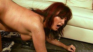 Shabby brunette mature gets banged with dildo machine