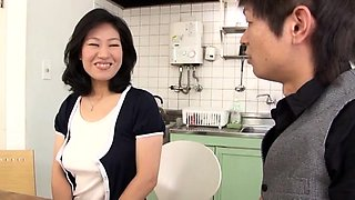 Stacked Japanese housewife has two boys sharing her pussy