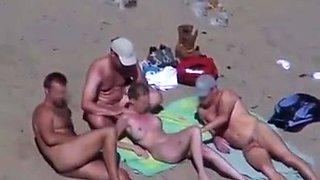 Cuckold couple on the beach