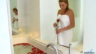 Sexy blonde mom seduces herself in a rose petal bath and