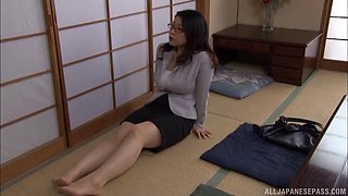 He watches the Japanese milf masturbate and strokes his cock