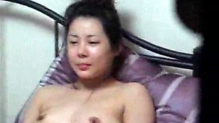 Korean old woman got voyeured laying naked on the bed