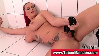 Redheaded mistress toys pierced pussy with whip in fetish
