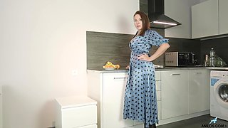 Chubby mature housewife Tanya Foxxx is masturbating pussy on the kitchen table