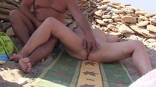 Masturbate on the beach.