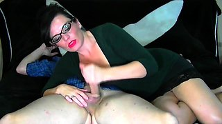 Big breasted milf with glasses delivers a sensual handjob