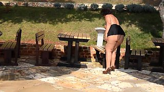 Mature Lady Naked Big Ass in Miniskirt Outdoors
